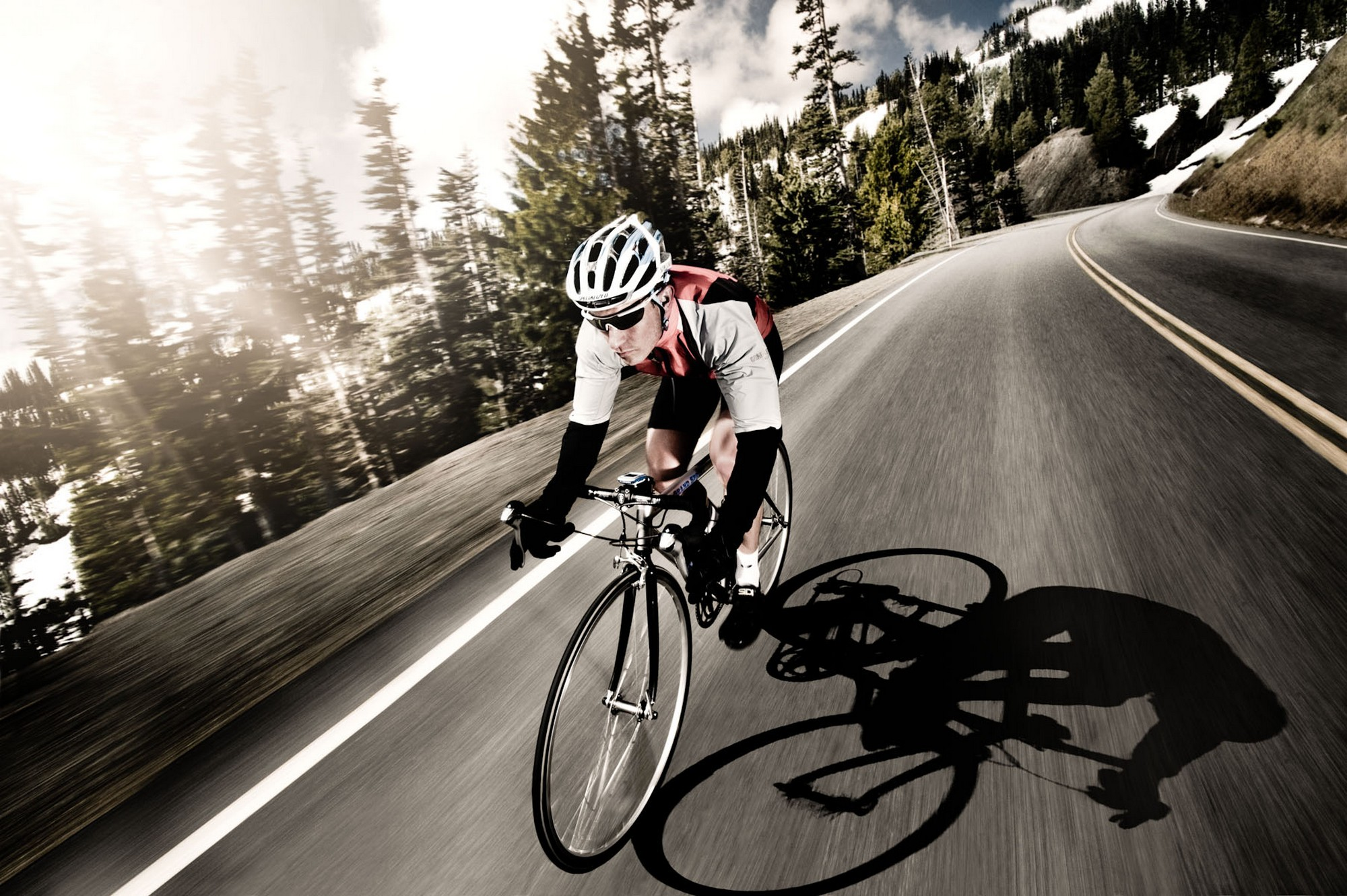 Athletic male high speed cycling in Olympic National Park, WA, USA