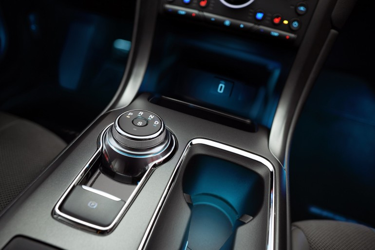All 2017 Ford Fusions, including the Sport model pictured here, include a new rotary gear shift dial that enhances the spaciousness of the cabin. New features including driver assist technologies, give consumers a combination of convenience, entertainment and a feeling of confidence behind the wheel.