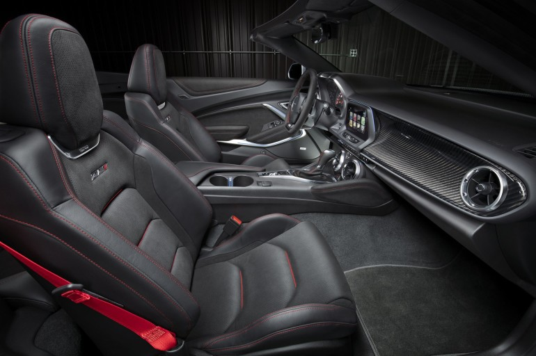 The driver-focused interior of the Camaro ZL1 features standard Recaro front seats, along with a sueded flat-bottom steering wheel and shift knob. Chevrolet's Performance Data Recorder is available, and allows drivers to record, share and analyze driving experiences on and off the track. The fully automatic top can be raised or lowered with a single button while driving up to 30 mph, or lowered remotely with the keyfob.