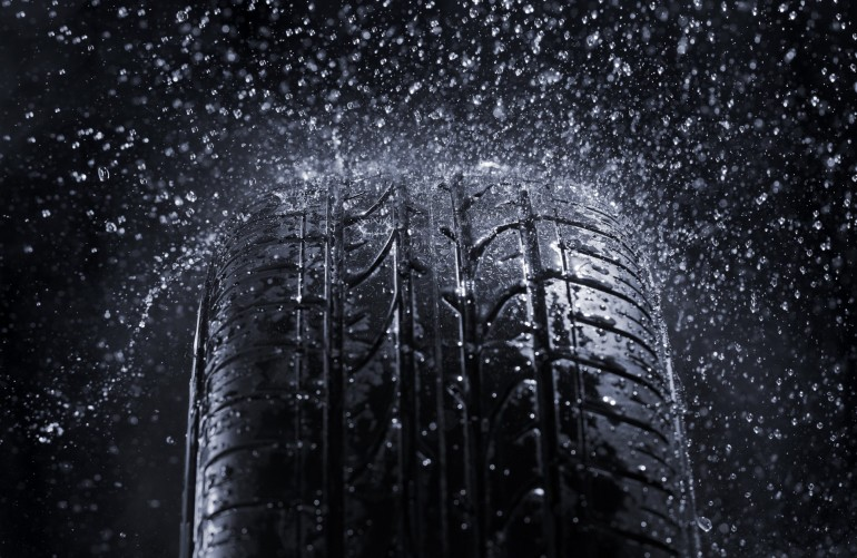 Car tire in rain