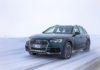 Audi A4 allroad 3/4 laterale anteriore sinistra in movimento su strada innevata