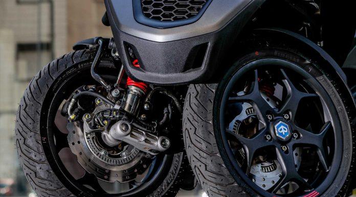 Piaggio MP3 500 2018 dettaglio ruote anteriori e freni a margherita